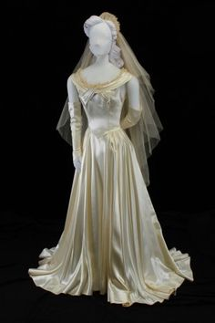 This 1948 ivory satin wedding dress with a fitted bodice and a gathered skirt with chapel train was specially made by Neiman-Marcus, in Dallas, TX, for the bride, Mrs. cousin of Mrs. Vintage Gowns, Vintage Bridal, Vintage Outfits, Vintage Fashion, 1940's Fashion, Vintage Clothing, Vintage Weddings, Bridal Fashion, Fashion History