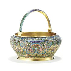 A RUSSIAN GILDED SILVER AND ENAMEL TEA CADDY, ANTIP KUZMICHEV, MOSCOW, 1894 enameled with colorful foliage with slip-on cover and interior stopper, retailed by Tiffany & Co., New York.