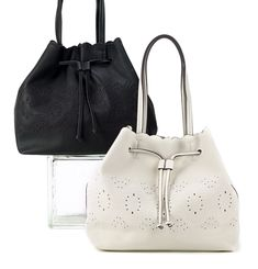 """Large drawstring tote with cutwork designin white soft faux leather. 14"""" x 6"""" x 13"""" zip and drawstring closure inside open pocket"""