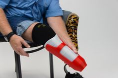 A man with a 3D printed composite prosthetic socket made on the Mark One