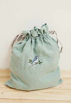 Linen Pouch With Hand Embroidered Bird | LaPetiteAlice on Etsy
