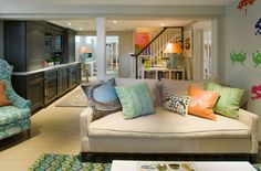 great basement idea -- bright graphic pillows