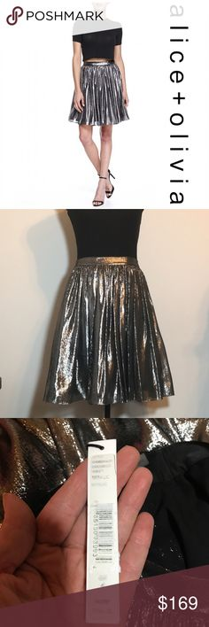 """Price drop🍾HPx2🍾Alice+Olivia metallic silk Skirt Lizzie metallic skirt by Alice + Olivia. This is such a GORGEOUS skirt!!! Brand new with tags. Pewter color which catches the light and is truly stunning! Size 4. Exterior is 75% silk and 25% polyester. Lined. Length measures 20"""". Waist band measures 13.5"""" across.  Check the TOP of my closet for current promotions and SALES!!! Alice + Olivia Skirts A-Line or Full"""