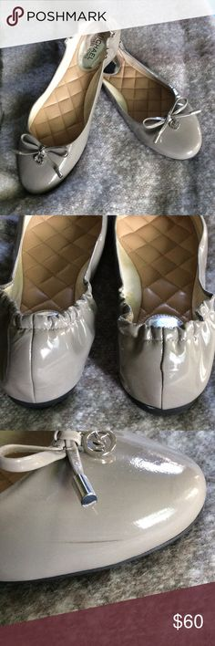Micheal Kors ballet shoes Beautiful pewter gray hue with pretty little bows and MK charms. Padded inside. Elastic back. Worn a few times. A slight scuff as shown. Leather. Michael Kors Shoes Flats & Loafers