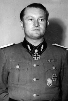 "SS-Standartenführer Karl Ullrich shortly after receiving his Oak Leaves to his Knight's Cross of the Iron Cross, Aug 1, 1944. At the time, Ullrich was commander of SS-Panzergrenadier-Regiment 6 ""Theodor Eicke""/3.SS-Panzer-Division ""Totenkopf"". One month after this photo was taken, he was promoted commanding officer of the 5. SS-Panzer-Division ""Wiking"". He died in 1996."