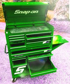 Green snap on roller cab tool chest.  Every garages dream
