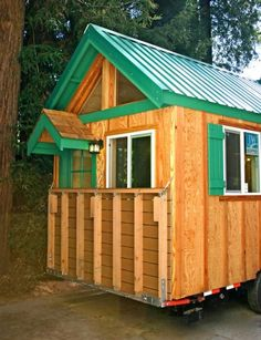 Nice Porch Functionality  By Molecule Tiny Homes, this tiny house features a porch which flips up and down.