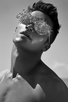 Model Mario Loncarski by Susanne Spiel and styled by Tanja Zeljak in a beach shoot, with hair and makeup by Alice Retzl.