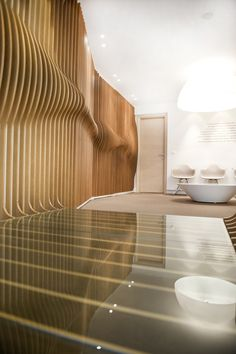 ORL Clinic, by Mal-Vi Architects  Thessaloniki, Greece  - beautiful curve in the wooden slats along the wall