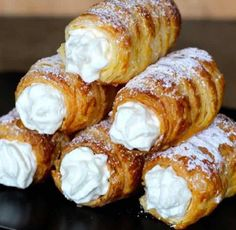 czech food Kremrole is a deliciously crispy roll Kremrole is a deliciously crispy roll-shaped puff pastry that is filled with meringue or whipped cream that is popular in the Czech Republic, Austria, Germany and Slovakia. Czech Desserts, Köstliche Desserts, Delicious Desserts, Dessert Recipes, Yummy Food, Slovak Recipes, Austrian Recipes, Czech Recipes, Puff Pastry Desserts