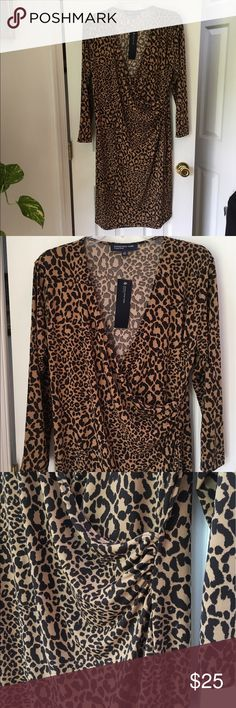 🐾 Jones New York Signature Animal Print Dress 🐾 🐾 Jones New York Signature Animal Print Dress  (NWT) - Size Large - The dress measures 38 inches from the neckline to hem.  This is a terrific dress, perfect for Day or Night, dress it up, or dress it down !! 🐾 Jones New York Dresses Midi