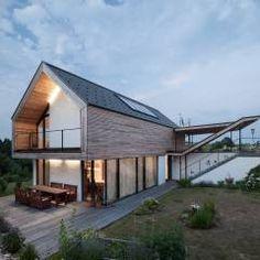 GOL 2 - Einfamilienhaus: translation missing: de.style.terrasse.modern Terrasse von g.o.y.a. Architekten