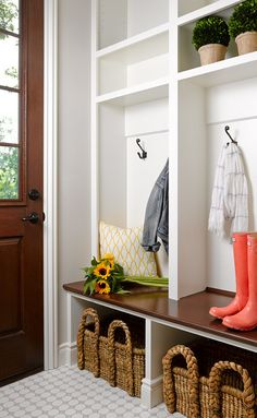 Cottage mudroom boasts stained wood and glass door opening up onto built-in lockers featuring open cubbies and an open storage bench filled with seagrass baskets atop a gray and white hexagonal tiled floor Mudroom Cubbies, Mudroom Laundry Room, Mudroom Benches, Built In Lockers, Home Lockers, Decoration Entree, Luxury Interior Design, Interior Ideas, My New Room