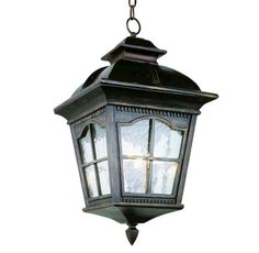 """3 Light 21.25"""" Antique Rust Outdoor Pendant has a colonial style with scalloped window frames and watered glass. - Color Finish: Antique Rust - Shade Description: Water Glass - Included Accessories: G"""