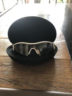 82e6e3eb1de This pair of sunglasses has been worn once. Matte black frame polarized  fire iridium lenses Hard shell case and cloth lense cleaner case are  included.
