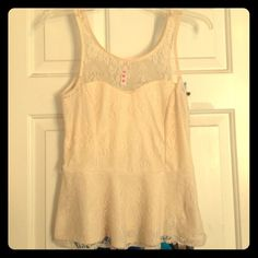 Cream Lace Peplum Tank Top Beautiful cream colored flared lace tank top with zipper on the left side. Goes great with a pencil skirt! Unfortunately I can't tell you the brand, but it does have a tag Tops Tank Tops