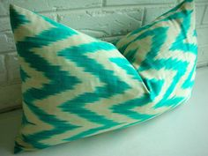 "Ikat Pillow Cover - Decorative Lumbar Throw - Jade Green Teal Turquoise Ivory - Modern Tribal - Chevron Zig Zag - Silk Cotton 12 x 20"". $65.00, via Etsy."