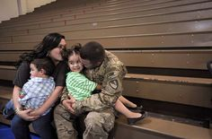 WELCOME HOME, and THANK YOU! Caption: Specialist Jose Franco hugs his daughter Isabel, 4, while his wife Elyshia and son Elijah look on, as he and other soldiers from the 530th Engineer Company return home from a one-year deployment in Afghanistan at Fort Stewart, Georgia, March 12, 2012. (Photo by Erik S. Lesser/EPA)