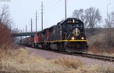 IC 1026, CN 8837, CN 5715 and 104 cars northbound at McLoud Place in Cedar Rapids, IA. The head two units were from an extra local overnight. 2/29/12