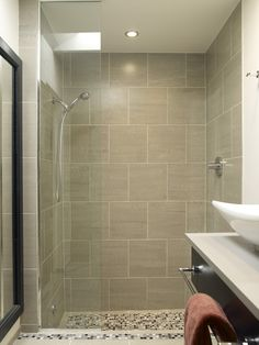 Large tile in the shower is very modern.