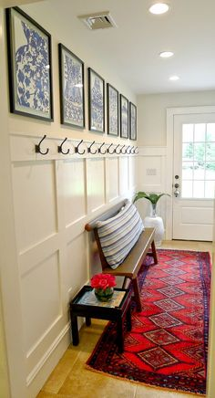 front entry - love the hooks and bench, a place for guests to put things and easily find it.