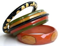 Bakelite boutique ~ bakelite bangles.  The bottom one is so unique, being faceted.  Love it!