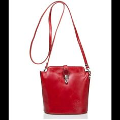 """Small Red Push-Lock Genuine Leather Cross-body Bag Genuine Italian leather in beautiful red!  7.5""""W x 7.5""""H x3.2""""D. 19.7"""" max. strap length. Flap closure. 2 compartments. One zip pocket interior. One zip pocket exterior. Removable strap. Made in Italy. Massimo Castelli Bags Crossbody Bags"""