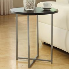 @Overstock - This go-anywhere accent table can easily find a place in any room in your home thanks to its simple and contemporary design. Constructed with a powder-coated metal base and a black MDF top, this table will add style and counter-top space to any room.http://www.overstock.com/Home-Garden/Manhattan-Contemporary-Accent-Table/7508849/product.html?CID=214117 $77.99
