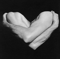 Robert Mapplethorpe #photography #arms #body #bodyparts #hug #heart #black #shadow #chiaroscuro