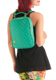 a cute bag big enough to carry a laptop, but small enough to be considered a purse... and it's a backpack so it can be hands-free!