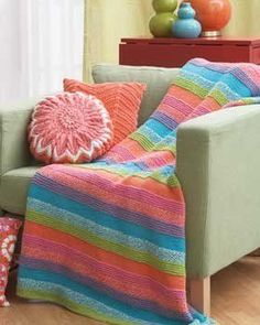 This knit afghan pattern is the quintessential summer project.  With pastel stripes of the garter stitch mixed with the bumpy seed stitch, this afghan is a cool blend of texture and color.  Drape this beautiful afghan over your couch and remember the