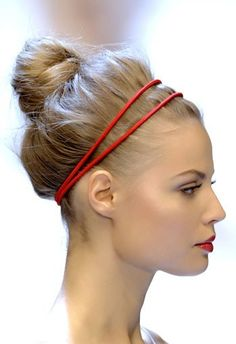For the next night out, try a high bun, classic red lip and matching head band.