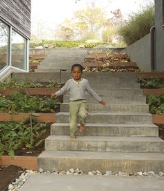 A Family-Friendly Landscape Design in Virginia Thanks to an earth-moving renovation, a hillside Virginia home located on a notch between two ridges becomes a place for play and repose.  Photo by Eli Meir Kaplan.