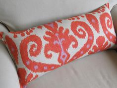 IKAT orange and lavendar large sofa pillow 12x25. $60.00, via Etsy.