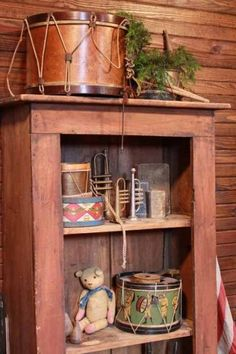 I could make a mini version of this display cabinet using those old ornaments that are shaped like horns & trumpets .I probably have tiny drums too that I could alter to look like these. Primitive Christmas, Country Christmas, Vintage Christmas, Primitive Decor, Christmas 2016, Christmas Decor, Barbie Vintage, Vintage Toys, Antique Toys