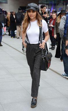 Platform shoes, pants, white top, black hat, suspenders