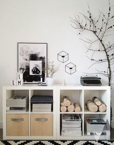 Transform the plain white Kallax shelving units into storage units with natural elements.