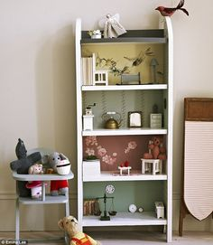 Such a cute idea, to use a bookshelf to make a dolls house...