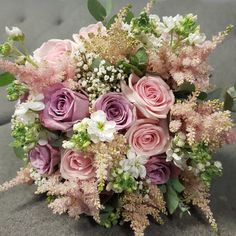 A loose and natural styled wedding bouquet including roses, gyp, astilbe and stocks #parsleyandsage #roseweddingbouquet #gypsophila #bridalflowers