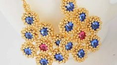 Beadwoven long earrings with Swarovski rivoli crystals. by Renarta