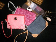 A collection of Coach wristlets