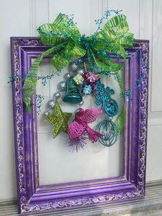 60 DIY Picture Frame Christmas Wreath Ideas that totally fits your Budget 60 DIY Picture Frame Christmas Wreath Ideas that totally fits your BudgetLooking for Decorations that totally fits your budget? Christmas Picture Frames, Christmas Frames, Christmas Projects, Holiday Crafts, Christmas Gifts, Christmas Ornaments, Christmas Pictures, Christmas Ideas, Picture Frame Wreath
