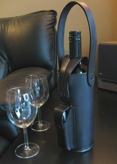Leather single wine bottle tote in black with bottle opener pouch.