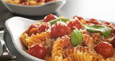 a baked dish of fusilli or pasta spirals with cherry tomatoes ricotta and parmesan. Fusilli, Ricotta, Creative Food, Cherry Tomatoes, Italian Recipes, Food And Drink, Dishes, Cooking, Ethnic Recipes