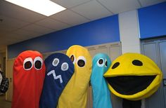 Pacman costume - 3 hulahoops and yellow & black felt with a back pack inside to wear it - mesh in mouth to see