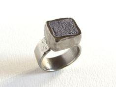 White bronze and lavender concrete ring by Feros Ferio, via Flickr