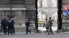 French authorities have opened a terror investigation after a soldier shot a man wielding a machete near the Louvre museum in Paris.