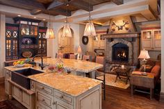 I love the idea of a cozy seating area with fireplace within the kitchen.