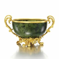 A FABERGÉ GOLD-MOUNTED NEPHRITE BOWL, WORKMASTER: MICHAEL PERCHIN, ST. PETERSBURG, CIRCA 1890 the oval bowl flanked with foliate scroll handles and supported on an exuberantly scrolling neo-rococo base, marked Fabergé with workmaster's initials and scratched inventory number 40880, 56 standard.