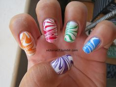 "Rainbow Skittle Water Marble - Wet N' Wild ""French White"" Sally Hansen X-treme Wear ""Cherry Red"" & ""Sun Kissed"" OPI  ""Funky Dunkey"" & Essie ""Mesmerized"" & ""Pretty Edgy"""